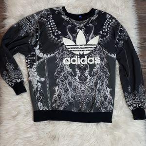 Adidas crewneck with peacock design fabric.